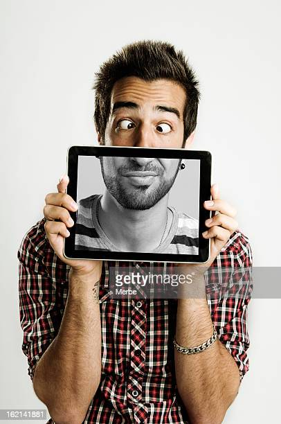 young man with a digital tablet