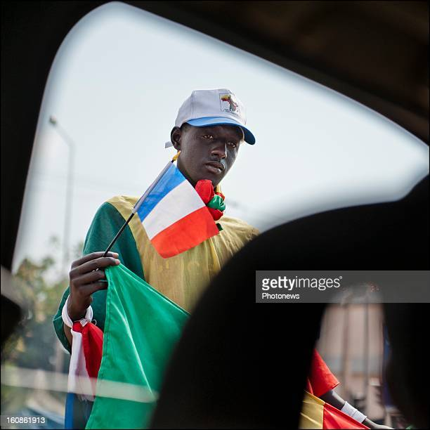 A young man with a French flag in his hand on January 24 2013 in Bamako Mali