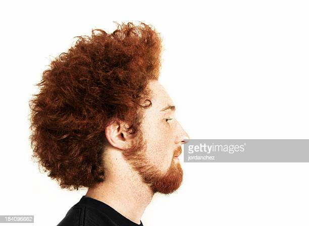 Young man with a ginger Afro and beard
