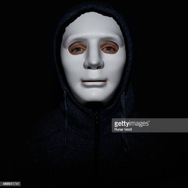 A young man with a mask