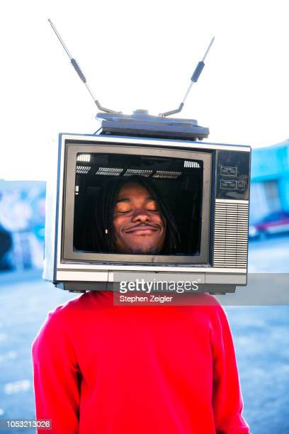 young man with a television on his head - american influenced stock photos and pictures