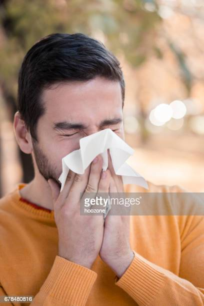 young man with allergies - tree man syndrome stock photos and pictures