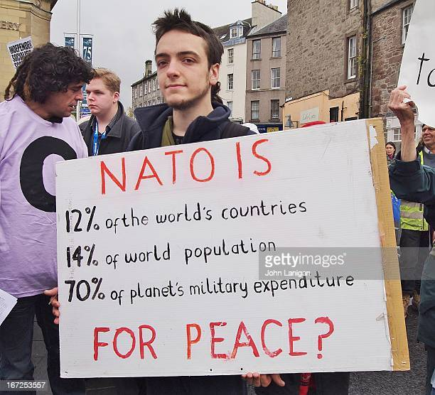 Young man with anti Nato placard