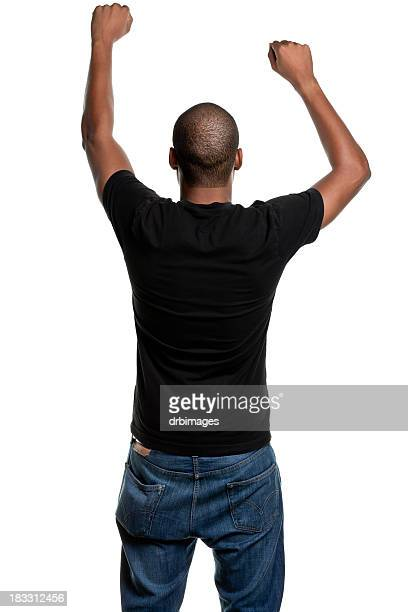 young man with arms up, shaking fists, rear view - op de rug gezien stockfoto's en -beelden