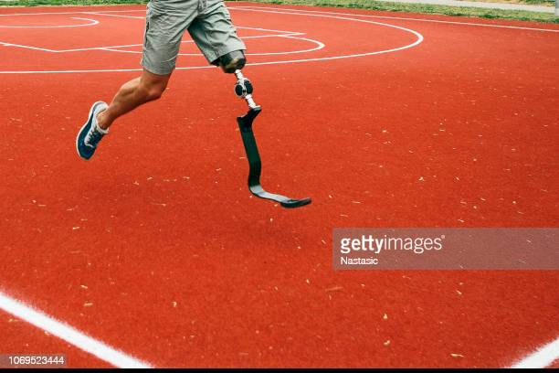 Young man with artificial limb running