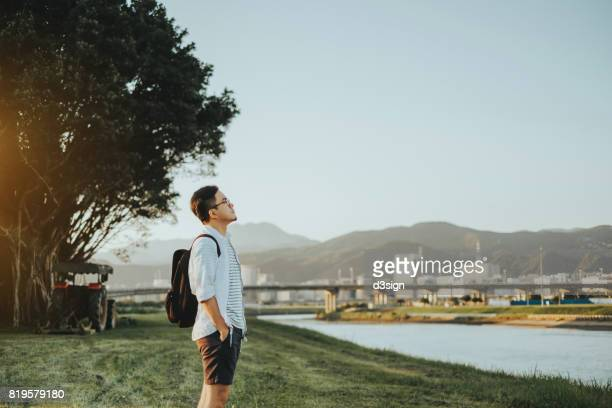 young man with backpacker enjoys the calmness in nature - holy city park stock pictures, royalty-free photos & images