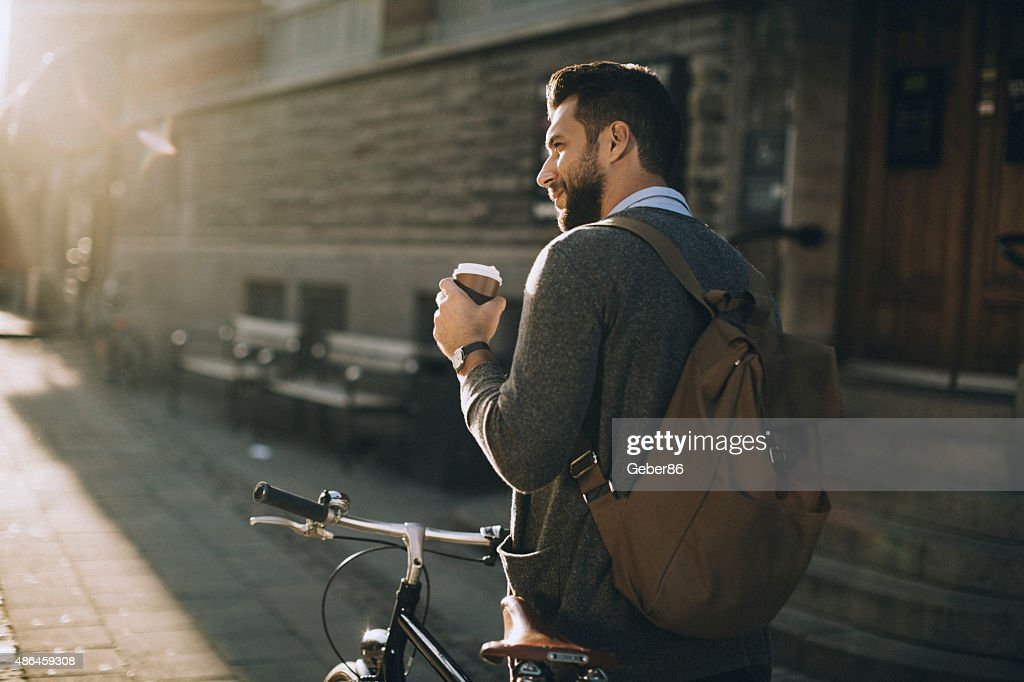 Young man with bicycle : Stock Photo