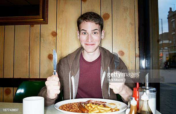 young man with big breakfast in cafe - anticipation stock pictures, royalty-free photos & images