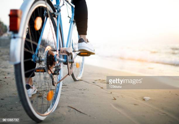 young man with bike - bicycle stock pictures, royalty-free photos & images