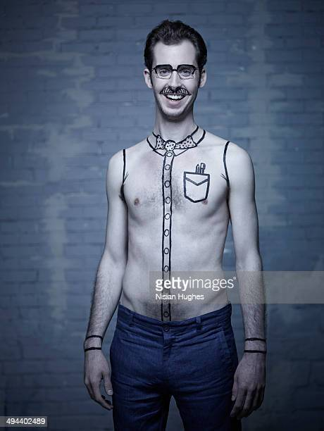 young man with black outline drawings on him
