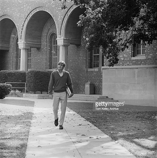 young man with books walking on campus - archival stock pictures, royalty-free photos & images