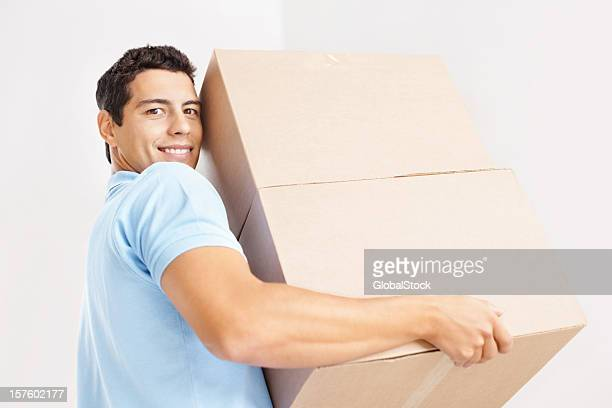 Young man with boxes moving into new home