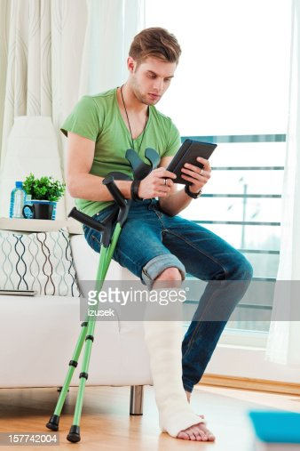 Young Man With Broken Leg At Home High-Res Stock Photo ...
