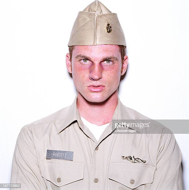 young man with broken nose wearing military uniform, upper secti - uniform cap stock pictures, royalty-free photos & images