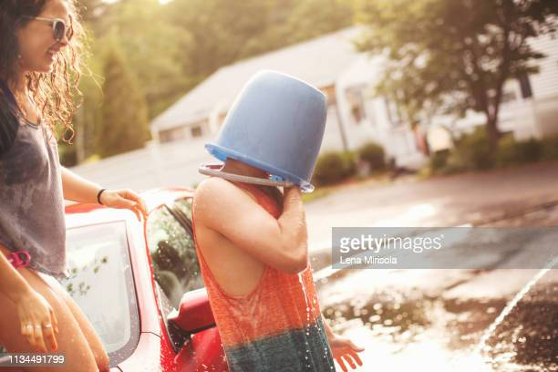 young man with bucket covering head - lena spoof stock pictures, royalty-free photos & images