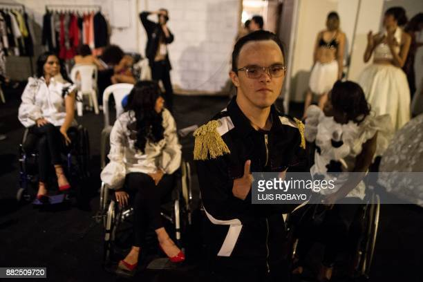 A young man with cognitive disability waits backstage before participating in the Walkway Inclusion fashion show in Cali Colombia on November 29 2017...