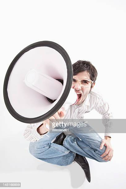 Young man with crazy glasses and megaphone, portrait