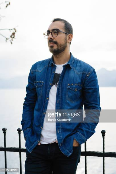 Young man with denim shirt standing outdoor