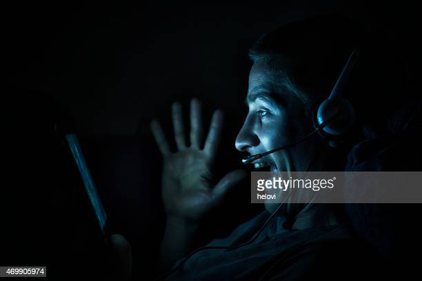 Young man with digital tablet at night