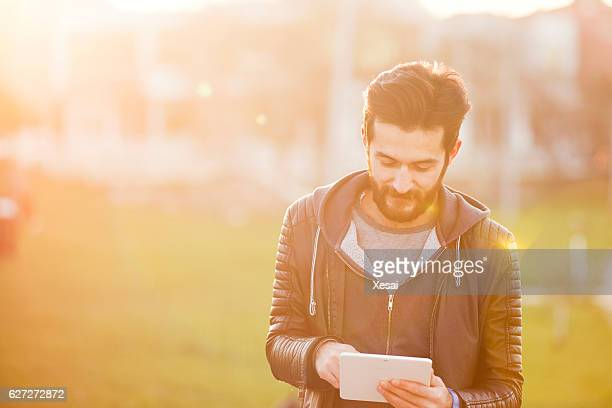 Young man with digital tablet in the city