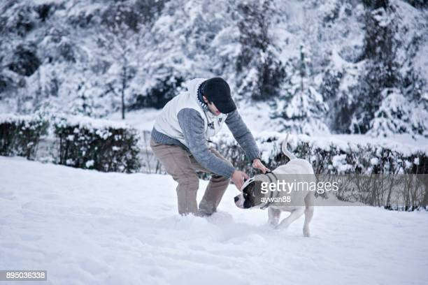 Young man with dog in the nature