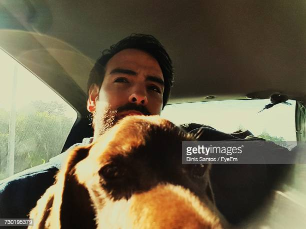 young man with dog traveling in car - seeing eye dog stock photos and pictures