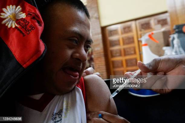 Young man with Down syndrome receives a dose of the Sputnik-V vaccine against COVID-19 at the military vaccination center Mariscal Zabala in...