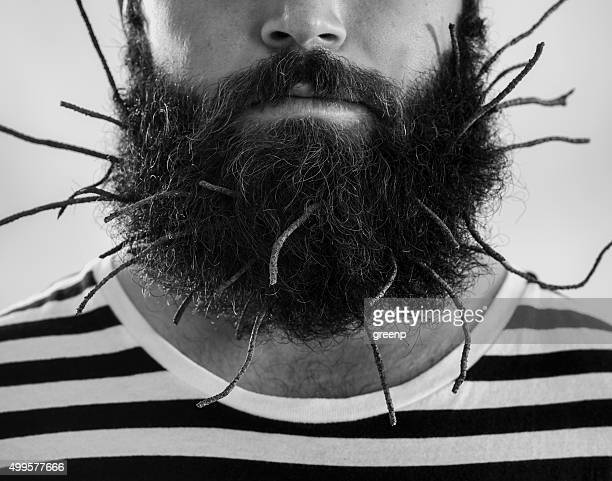 young man with dried boughs in beard - dry mouth stock photos and pictures