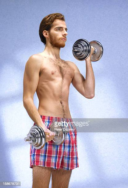 young man with eating disorder working out - anorexia nervosa imagens e fotografias de stock