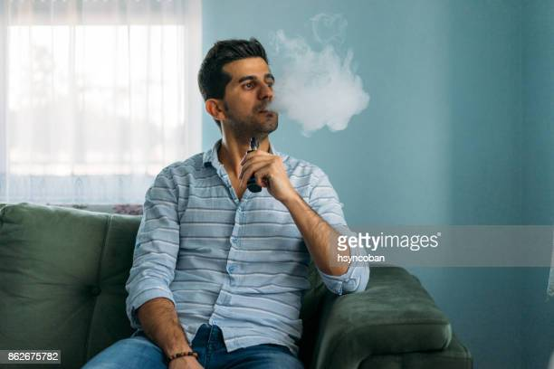 Young Man With Electronic Cigarette