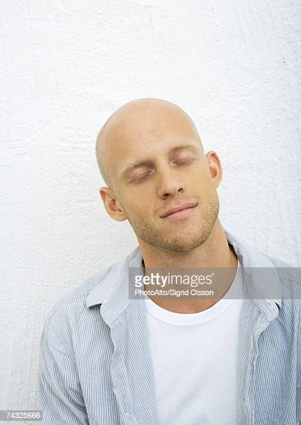 young man with eyes closed, portrait - completely bald stock pictures, royalty-free photos & images