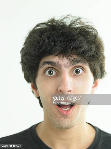 Young man with eyes wide open, portrait