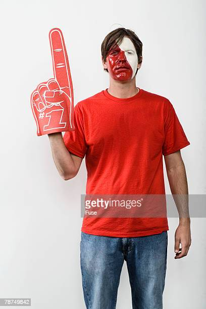 young man with foam rubber finger - foam finger stock photos and pictures