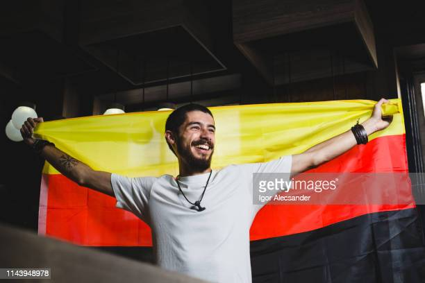 young man with germany flag - german flag stock pictures, royalty-free photos & images