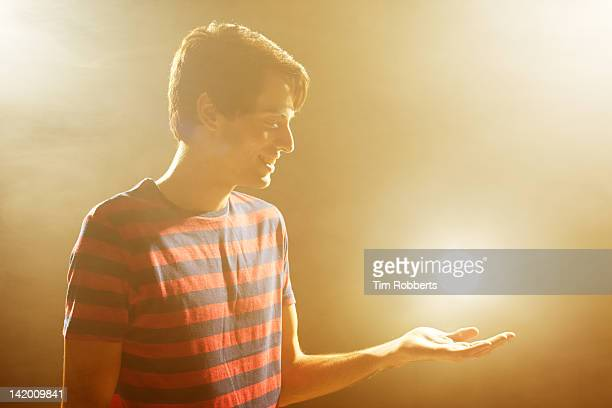 young man with glowing light, smiling. - glowing stock pictures, royalty-free photos & images