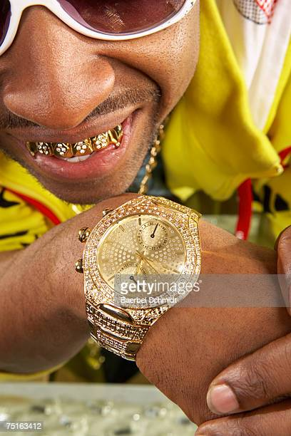 young man with gold teeth and watch, close-up - gold tooth stock photos and pictures
