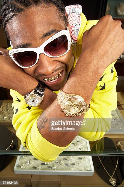 young man with gold teeth and watches, close-up - gold tooth stock photos and pictures