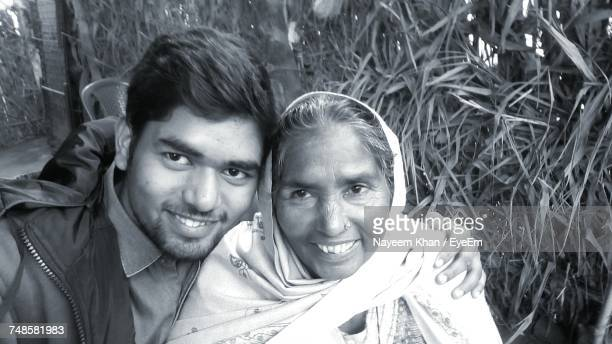 Young Man With Grandmother By Plants