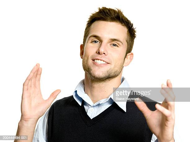 young man with hands in air smiling, portrait - clenching teeth stock pictures, royalty-free photos & images