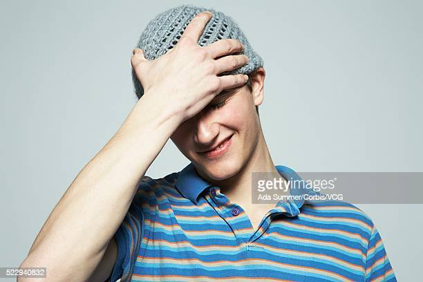 Young man with hands on head