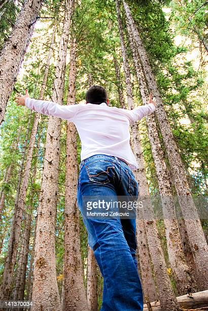 Young man with hands outstretched