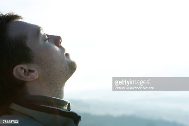 young man with head back and eyes closed, mountains in background - inhaling stock pictures, royalty-free photos & images