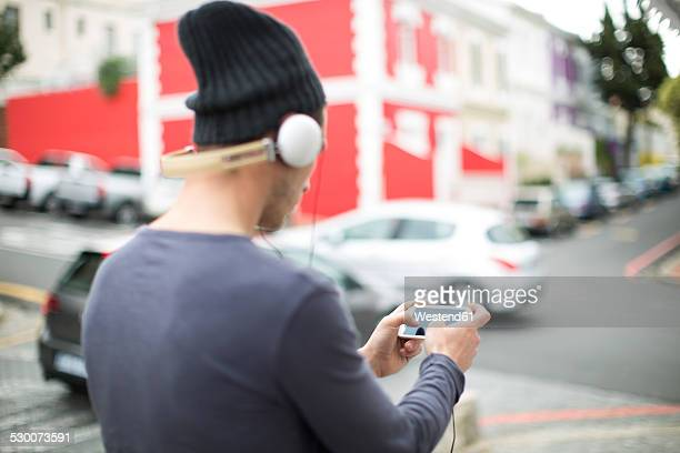 Young man with headphones and smartphone listening music