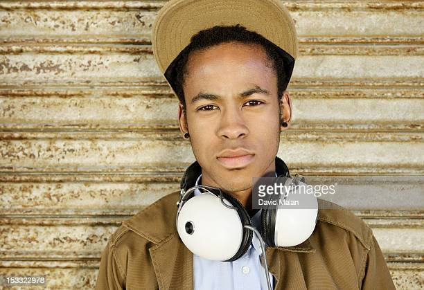 Young man with headphones around his neck.