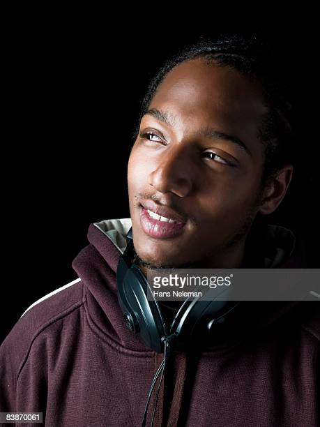Young man with headphones around their neck