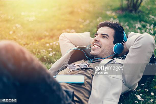 Young man with headphones enjoying the music