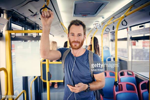young man with headphones on a bus - transporte público imagens e fotografias de stock
