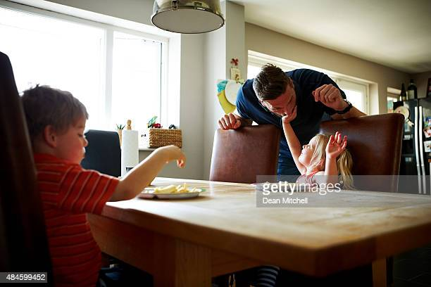 Young man with his children at dining table