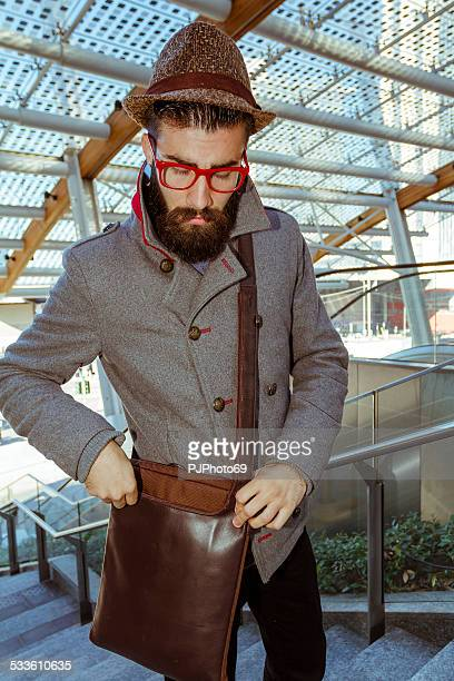 Young man (Hipster style) with his shoulder bag