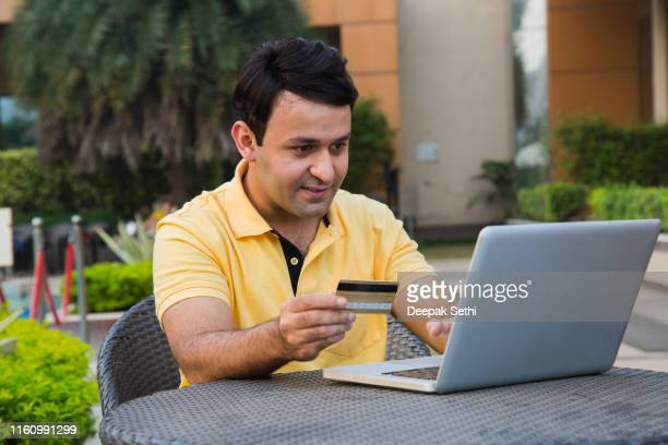 young man with laptop - stock images - south asia stock pictures, royalty-free photos & images